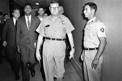 Heavyweight boxing champion Muhammad Ali is escorted from the Armed Forces Examining and Entrance Station April 28, 1967 in Houston by Lt. Col. J. Edwin McKee, commandant of the station, after Ali refused Army induction. Ali never spent a day in prison for his actions even though he was sentenced to serve five years for draft evasion before the Supreme Court overturned his case on a technicality. But many black athletes have paid when taking a stand, or a knee,  for speaking out for social or political change. Ali lost the heavyweight title and spent three years in forced exile from the ring.