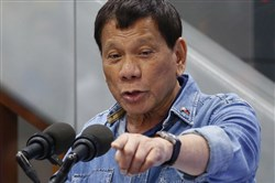 In this Feb. 13, 2018, file photo, Philippine President Rodrigo Duterte addresses Filipino Overseas Workers who were repatriated from Kuwait at the Ninoy Aquino International Airport in suburban Pasay city, southeast of Manila, Philippines.