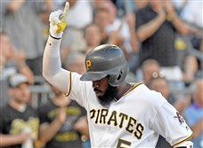 Pirates Josh Harrison crosses home plate after hitting a home run against the Cardinals in the first inning August 18 at PNC Park.