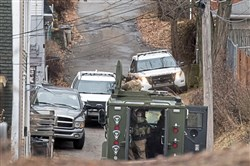 A SWAT team sets up in Alford Way after they were called to a home on Celadine Street in Stanton Heights on Wednesday.