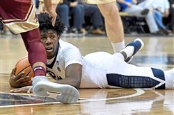 Pitt's Marcus Carr dives for a loose ball against Boston College.