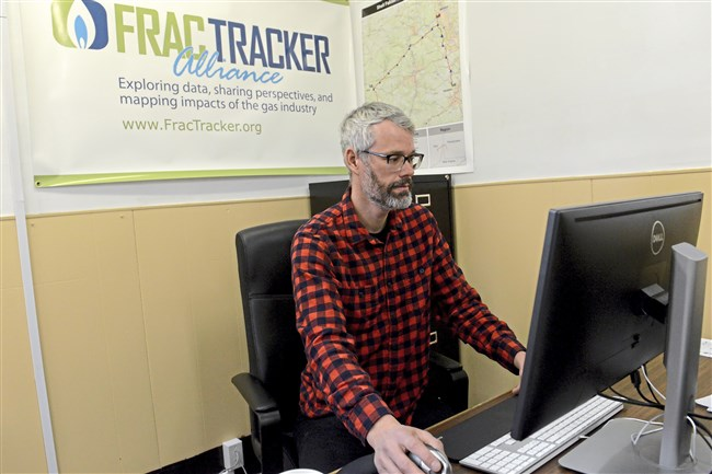 Kirk Jalbert of FracTracker Alliance in his office in Millvale. Mr. Jalbert found data on oil and gas projects and disseminate it to activist groups who are trying to stop or weigh in on certain projects.