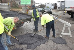 A pothole is filled by the City of Pittsburgh's Department of Public Works 3rd Division last week.