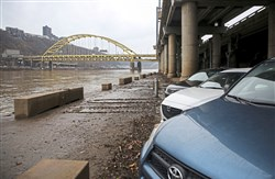 Cars parked at the Mon Wharf along the Monongahela River in Downtown Pittsburgh last week.