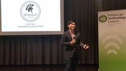 Joey Kim, an associate with Boston's Romulus Capital, visited the North Side's Alloy 26 to discuss the inner workings of venture capital financing.