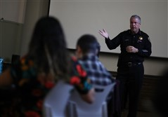 Oakland school police Chief Jeff Godown (R) talks with Oakland Unified School District staff during an active shooter training at Cole Elementary School on February 16, 2018, in Oakland, California.