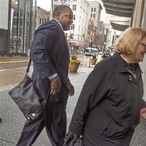 Superintendent Anthony Hamlet and school board member Cynthia Falls enter a bargaining session with the Pittsburgh Federation of Teachers earlier this month.