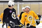Phil Kessel jokes with Evgeni Malkin during Friday's practice.