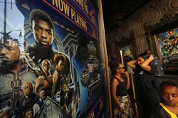 "Young moviegoers wait to attend a screening of the movie ""Black Panther"" on February 17, 2018, at El Capitan Theatre in Hollywood, Calif."