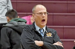 Cardinal Wuerl North Catholic head coach Dave Long calls out to his team Feb. 16 against Ellwood City at Ambridge High.