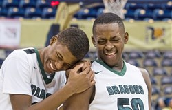 Allderdice's Terrell Childs, left, and Shaun Morris react after beating Westinghouse, 66-46, during the City League Championship at Petersen Events Center.