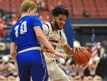 Central Connecticut's Austin Nehls, left, tries to guard RMU's Charles Bain as he drives during Saturday night's game at the Palumbo Center.