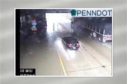 "A car splashes into pooling water in the left lane of the ""bathtub"" section of Interstate 376 in Downtown on Monday."