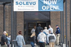 Customers line up to purchase medical marijuana Thursday, outside Solevo Wellness in Squirrel Hill.