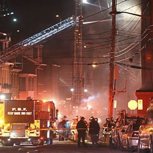Pittsburgh firefighters battle a smoky multi-alarm fire in the Appliance Warehouse building on South Sixth and Bingham Sts. Sunday, Feb. 18, 2018, on the South Side.