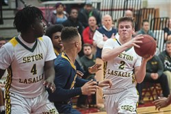 Seton LaSalle's Matt Banbury drives to the hoop against South Allegheny in the first round of the WPIAL Class 3A boys basketball playoffs Monday at Peters Township.
