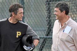 David Freese talks with team owner Bob Nutting Tuesday.