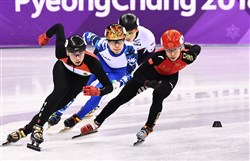 Hungary's Sandor Liu Shaolin leads China's Han Tianyu, Russia's Semen Elistratov and USA's John-Henry Krueger in the men's 500-meter short track speed skating heat event during the Pyeongchang 2018 Winter Olympic Games on Tuesday.