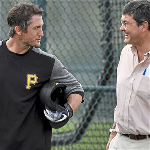 David Freese talks with Pirates owner Bob Nutting during workouts at Pirate City Tuesday in Bradenton, Fla.