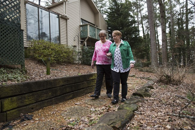 Susan Yarbrough, 49, and her 83-year-old mother Betsy Yarbrough at the home they share in Johns Creek, Ga.
