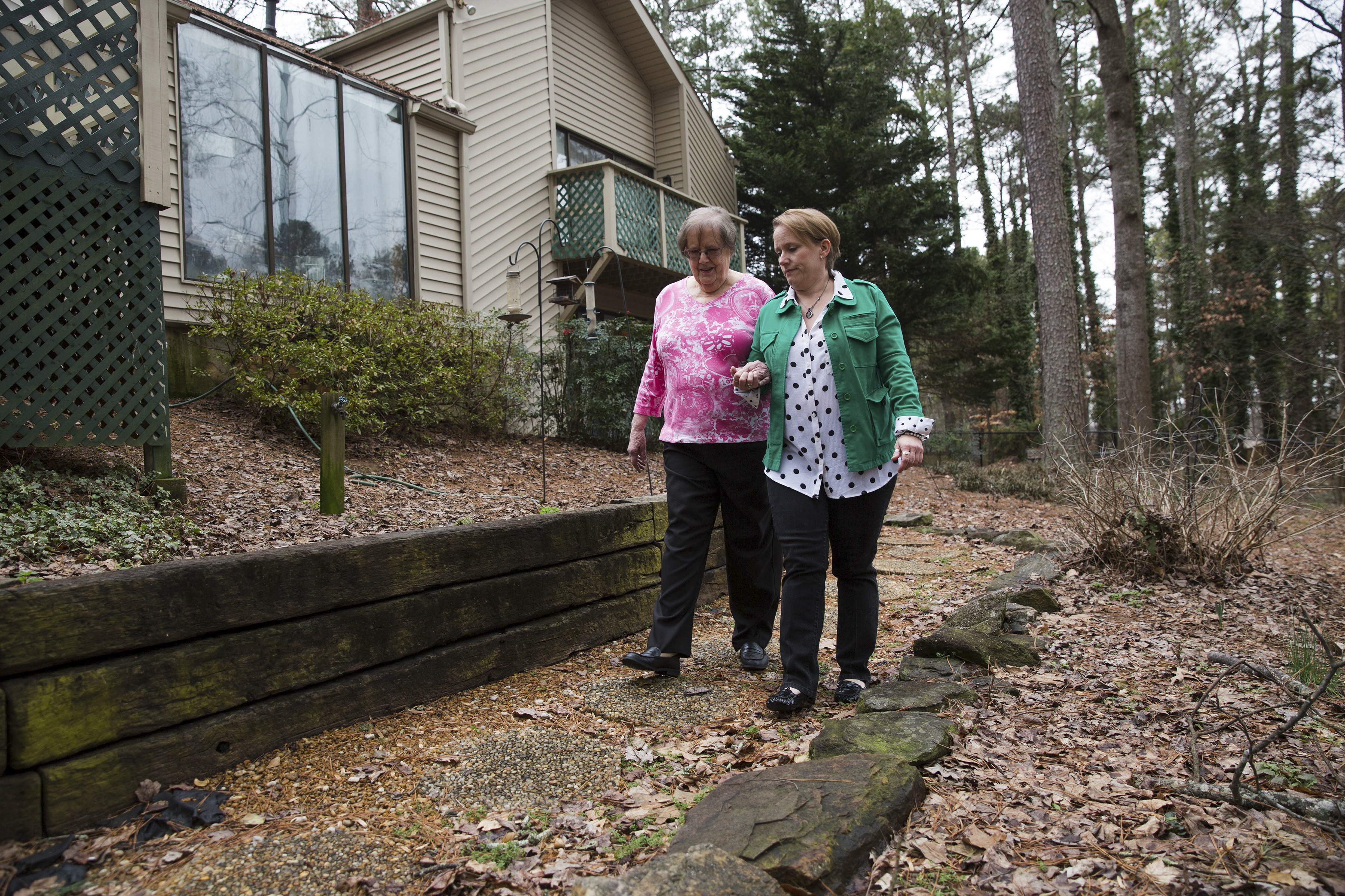SCI SHARED LIVING 2 Susan Yarbrough, 49, and her 83-year-old mother Betsy Yarbrough at the home they share in Johns Creek, Ga.