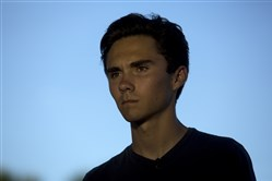 This file photo shows David Hogg, 17, a survivor of the Marjory Stoneman Douglas High School mass shooting, in Parkland, Fla., on Feb. 15, 2018.