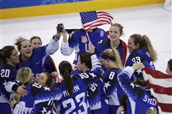 The United States women's team celebrates winning gold after their hockey game against Canada at the 2018 Winter Olympics in Gangneung, South Korea, Thursday, Feb. 22, 2018.