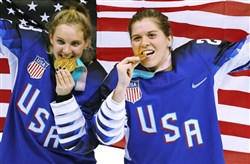 Gold medal winners Amanda Kessel, left, and Hannah Brandt celebrate after defeating Canada in a shootout during the women's hockey game at the PyeongChang 2018 Winter Olympics in South Korea.