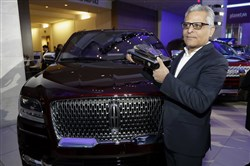 FILE- In this Jan. 15, 2018, file photo, Kumar Galhotra, group vice president for Lincoln stands next to the 2018 Lincoln Navigator after the vehicle won truck of the year during the North American International Auto Show in Detroit. Ford Motor Co. said Thursday, Feb. 22, that it is naming Galhotra as a replacement for Raj Nair, the president for North America who was ousted this week over allegations of inappropriate behavior. Galhotra will take over on March 1. (AP Photo/Carlos Osorio, File)