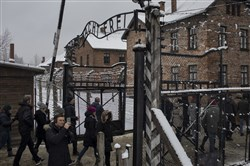 Visitors at the Auschwitz-Birkenau memorial and museum in Oswiecim, Poland, Feb. 4, 2018.