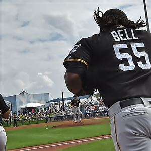 The Pirates' Chris Bostick and Josh Bell take the field as they open the springl season Feb. 23 against the Rays at Charlotte Sports Park.