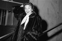In this Dec. 10, 1955 file photo, actress Nanette Fabray poses as she leaves Mt. Sinai hospital in New York.