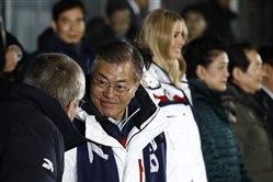 South Korean President Moon Jae-in, second from left, speaks with International Olympic Committee president Thomas Bach at the closing ceremony of the 2018 Winter Olympics at Pyeongchang Olympic Stadium on February 25, 2018 in Pyeongchang-gun, South Korea.