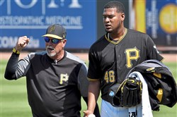 Pirates pitching coach Ray Searage walks with Ivan Nova before taking on the Red Sox at LECOM Park Feb. 26.