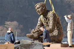"Workers install the Fred Rogers' statue ""Tribute to Children"" on the North Shore on Tuesday. The statue was removed from the site along North Shore Drive"