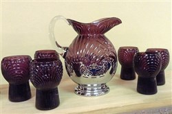 Pitcher and tumbler set made by Cambridge Glass Co. in the 1930s. Beverage ware is a popular collectible.