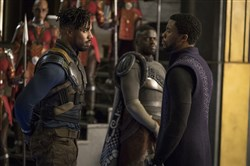 "From left, Michael B. Jordan and Chadwick Boseman, with Daniel Kaluuya in the background, in the film, ""Black Panther."""