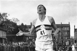 In this May 6, 1954, photo, British runner Roger Bannister breaks the tape to become the first man ever to break the four-minute barrier in the mile at Iffly Field in Oxford, England.