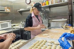 Bernadette Kazar makes pierogies at Dorothy 6 Blast Furnace Cafe, which is owned by her brother, Tom Kazar.