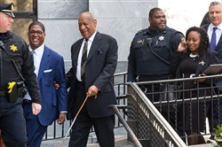 Bill Cosby exits the Montgomery County Courthouse after a pretrial hearing in a sexual assault case March 6, 2018, in Norristown, Pa.