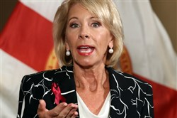 In this file photo, U.S. Secretary of Education Betsy Devos speaks during a news conference at the Marriot Heron Bay in Coral Springs, Fla., after meeting with students at Marjory Stoneman Douglas High School in Parkland on March 7, 2018. Devos will chair a new federal commission on school safety.