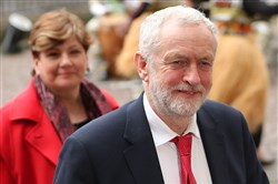 Britain's opposition Labour party Leader Jeremy Corbyn (R) and Britain's opposition Labour party's Shadow Foreign Secretary Emily Thornberry attend a Commonwealth Day Service at Westminster Abbey in central London on March 12, 2018.