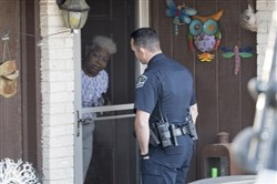 Authorities investigate the scene in East Austin after a teenager was killed and a woman was injured in the second Austin package explosion in the past two weeks March 12, 2018.