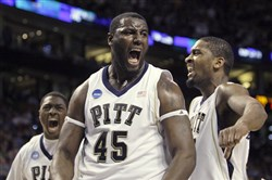 DeJuan Blair reacts while flanked by guards Ashton Gibbs, left, and Brad Wanamaker, right, during a March 2009 game against Villanova