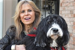 Linda Shooer and Leo, her 10-year-old  Portuguese water dog, at their Moon home.  For 10 years they have been making regular therapy dog visits to the Children's Institute in Squirrel Hill.