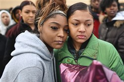 Tamara Donald, left, and Indeav Oneal were among 800 Penn Hills High School students who walked out of classes Wednesday to protest last month's school shootings at Parkland, Florida.