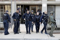 Evanston police officers leave after an investigation at Northwestern University Engelhart graduate residence hall in Evanston, Ill., on March 14, 2018.