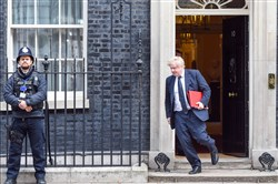 In this file photo, U.K. Foreign Secretary Boris Johnson departs 10 Downing Street after attending a National Security Council meeting on March 14, 2018, in London.