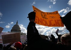 Students from Washington-area schools gather during a rally at the U.S. Capitol to urge Congress to take action against gun violence on March 14, 2018, in Washington.