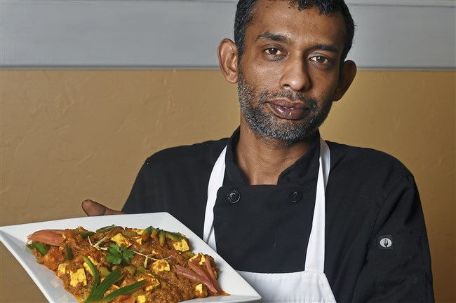 Chef Tamilselvan Thangadurai of Spice Affair is holding Kahrahi paneer.